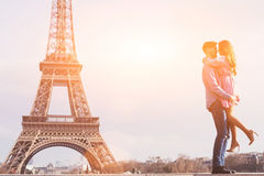 Couple near Eiffel tower, love, honeymoon in Paris Royalty Free Stock Image