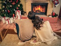 Couple near fireplace Royalty Free Stock Photography