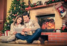 Couple near fireplace Stock Images