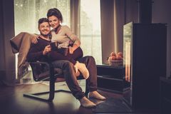 Couple near fireplace at home Royalty Free Stock Photography
