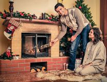 Couple near fireplace Stock Photography