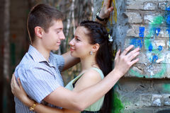 Couple near graffiti Royalty Free Stock Photo