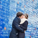 Couple near I love you wall in Paris Royalty Free Stock Images