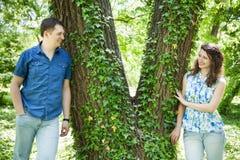 Couple near ivy tree Stock Photos