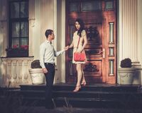Couple near luxury house Royalty Free Stock Photo