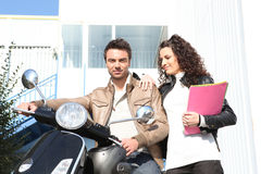 Couple near a motorcycle royalty free stock images