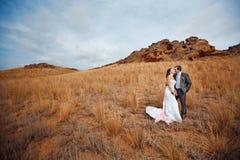 Couple near the mountains Stock Image