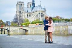 Couple near Notre-Dame de Paris Stock Photo