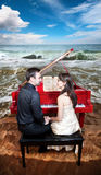 Couple near the piano on the beach Stock Images