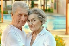 Couple near pool Stock Images
