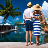 Couple near poolside Stock Photography