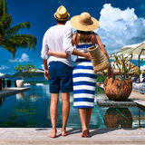 Couple near poolside Stock Images