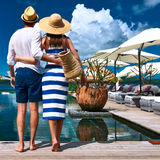 Couple near poolside Stock Photos