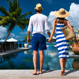 Couple near poolside Stock Image