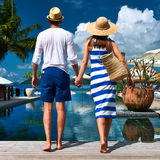Couple near poolside Royalty Free Stock Photos