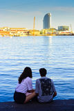 Couple near Port Vell. Barcelona, Catalonia, Spain. Rear view of a couple watching sea in harbour Port Veil Royalty Free Stock Images