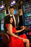 Couple near slot machine Stock Image