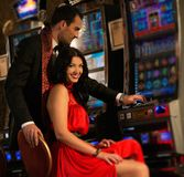 Couple near slot machine Royalty Free Stock Photo