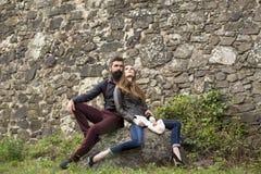 Couple near stony wall Royalty Free Stock Photos