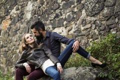 Couple near stony wall Stock Photo