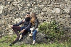 Couple near stony wall Stock Photos