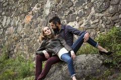Couple near stony wall Stock Photography