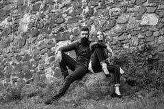 Couple near stony wall Royalty Free Stock Image