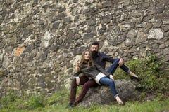 Couple near stony wall Stock Image