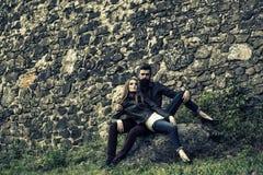 Couple near stony wall Stock Images