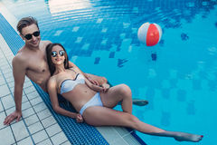 Couple near swimming pool Stock Photo