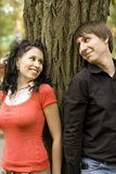 Couple near the tree. Happy young couple near the tree Stock Photos