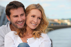 Couple near water. Affectionate couple stood by lake Royalty Free Stock Photo