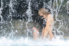 Couple near waterfall Royalty Free Stock Images