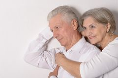 Couple near white wall Stock Image