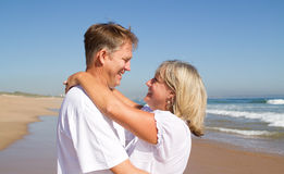 Couple neck hugging Stock Photos