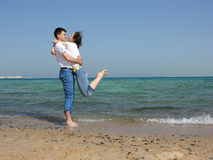 Couple. on neck. sea Royalty Free Stock Image