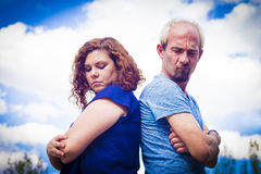 Couple in negative attitude angry. Transmitting emotional tension Royalty Free Stock Photos