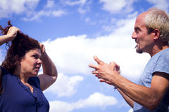 Couple in negative attitude angry. Transmitting emotional tension royalty free stock image