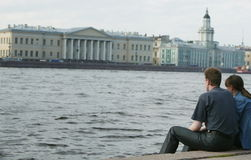 Couple and neva river. Couple on the bank of Neva river Royalty Free Stock Images