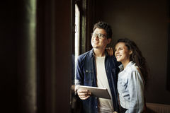 Couple New Apartment Thinking Dreaming Concept.  Stock Photography