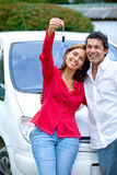 Couple with new car Royalty Free Stock Image