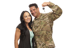 Couple with new car key. Soldier and his wife with new car key on white background Stock Image