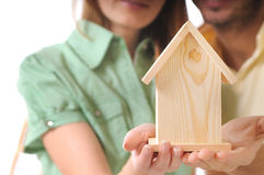 Couple and new home. Young couple and little home in the hands Stock Photos