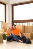 Couple in new home. Couple sitting with unpacked boxes in new home Stock Photos
