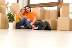 Couple in new home. Couple sitting with unpacked boxes in new home Stock Photography