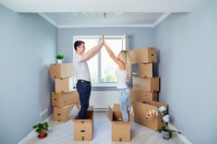 Couple in a new house, apartment. stock photos