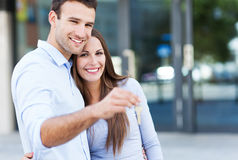 Couple with new house keys. Couple showing their new house keys Stock Photography