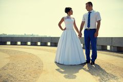 Couple of newlyweds on the embankment Royalty Free Stock Image