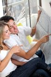 Couple with the newspaper Royalty Free Stock Photography