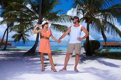 Couple nex to Palm tree Royalty Free Stock Images